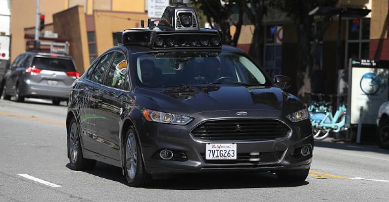 An Uber self-driving car drives down 5th Street in March 2017 in San Francisco.