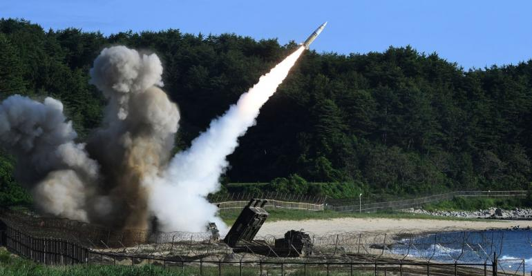 In this handout photo released by the South Korean Defense Ministry,  U.S.  M270 Multiple Launch Rocket System firing an MGM-140 Army Tactical Missile during a U.S. and South Korea joint missile drill aimed to counter North Korea's intercontinental ballistic missile test on  July 5, 2017 in East Coast, South Korea.