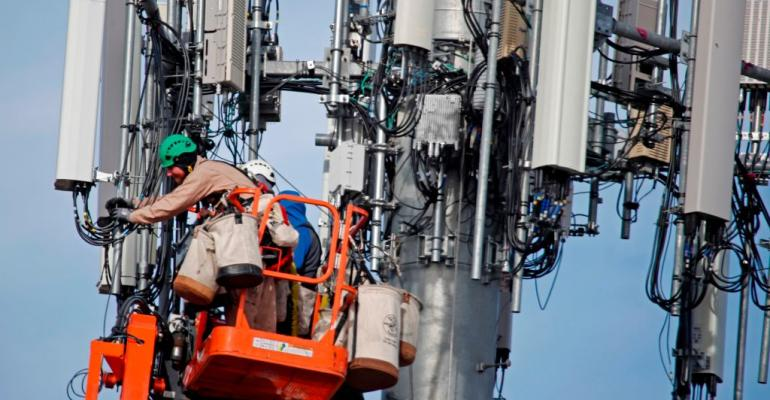 A contract crew for Verizon, works on a cell tower to update it to handle the new 5G network in Orem, Utah on December 10, 2019.