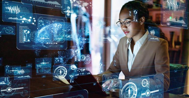 young female engineer with graphics and cloud overlays