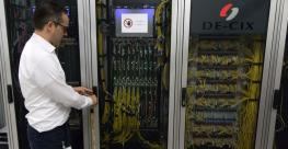 Thomas King, now CTO at the German internet exchange operator DE-CIX (Deutscher Commercial Internet Exchange), opens a server cabinet at a data center in Frankfurt. (2018)