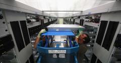 Staff work at the CERN data center in Meyrin, Switzerland, in 2017