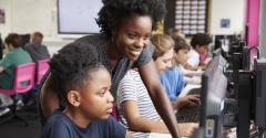 girls who code child coding on computer
