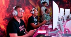 Visitors play Doom in the cloud at the Google Stadia stand at Gamescom 2019 in Cologne.