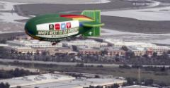 "The Greenpeace Airship A.E. Bates flies over Silicon Valley in 2014 with a banner asking ""Who's The Next To Go Green?"""