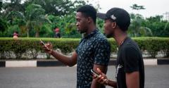Two young men play the mobile AR game Pokemon Go on the campus grounds of the University of Lagos in Lagos, Nigeria, in 2016.