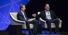 VMware CEO Pat Gelsinger (L) shares the stage with Dell Technologies founder and CEO Michael Dell at VMworld 2017.
