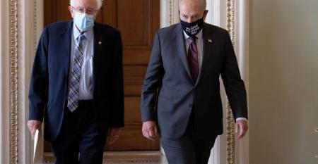 Sen. Bernie Sanders (L) (I-VT) walks with Senate Majority Leader Chuck Schumer (D-NY).