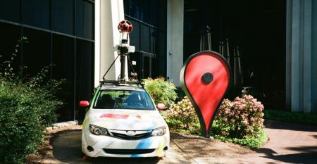 A Google Streetview car and an oversized Google Maps pin parked in front of the Google Maps building at the Googleplex in Mountain View (2018)