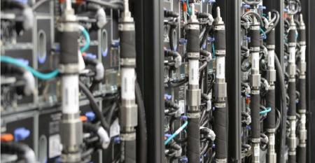 Racks filled with Lenovo servers and cooled by Lenovo's DTN (Direct to Node) liquid cooling system at LRZ, or the Leibniz Supercomputing Center, located outside of Munich