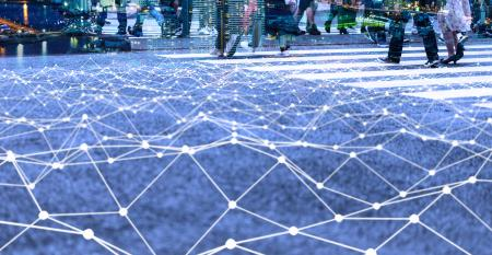 Image shows a walking crowd and mesh communication network concept.