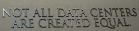 The sign over the entrance to the equipment area bearing the i/o Data Centers motto.