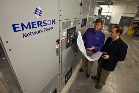 Staff from Emerson Network Power staff check out the power switchgear at its new data center in St. Louis.