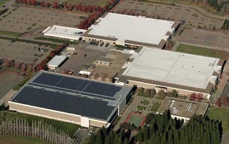 An aerial view of the Sonoma Mountain Village campus, showing the solar array next to the planned data center facility.