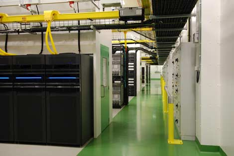 A view of the server pods in the Microsoft Dublin data center, showing the hot air containment structures enclosing the rear of the cabinets (click for larger version of image).
