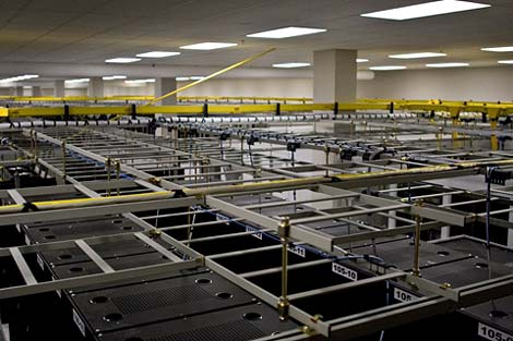 A view of the rows of racks packing a pod inside the QTS Downtown Atlanta data center.
