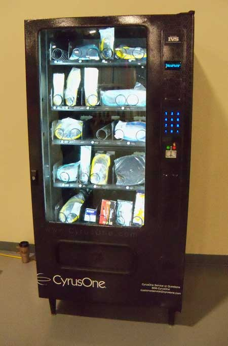 A vending machine is fully stocked with a variety of cables and connectors that customers may need, provided at cost by CyrusOne. (Photo: Rich Miller)