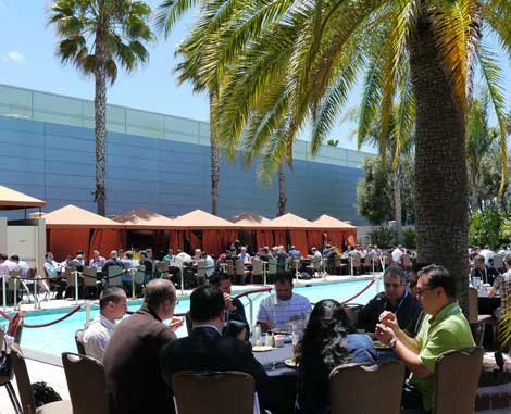 The Hyatt hotels' poolside setting for Wednesday's lunch was perfect on the June day.