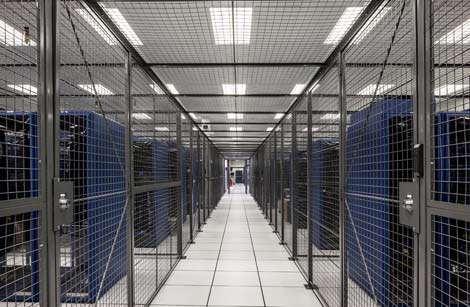 The colocation cages inside the server room of a Xand data hall. The company has more than $200 million in borrowing power as it continues its expansion. (Photo: Xand)