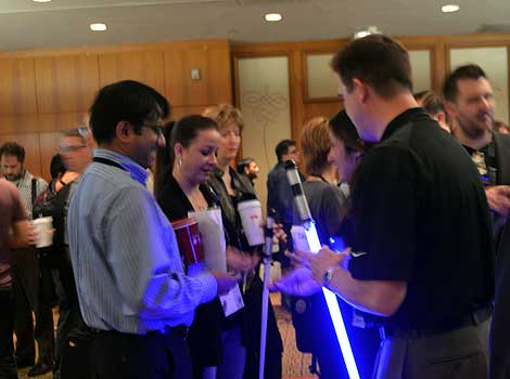 There's conference giveaways, then there's conference giveaways. Verisign was attracting a lot of attention with its glowing Star Wars lights abers. What no purple ones? Oh, they're only for Mace Windu. (Photo by Colleen Miller.)