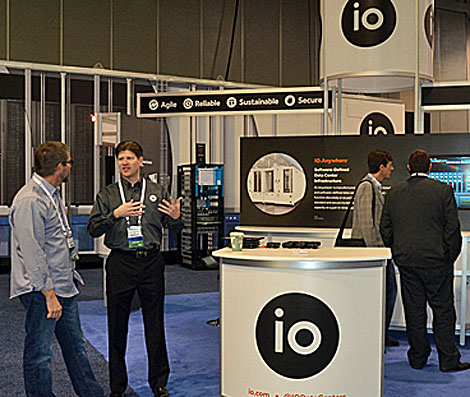 IO, data center provider headquartered in Phoenix, was on hand with its video displays of its monitoring capabilities, as well as its modular prefabricated data center product. (Photo by Colleen Miller.)