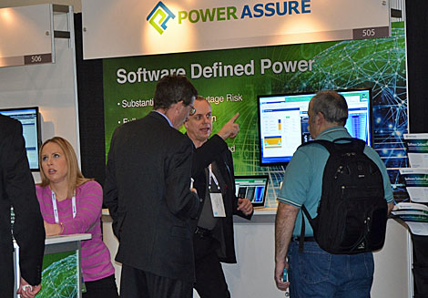 Power Assure's Clemens Pfeiffer speaks with attendees at the company booth. (Photo by Colleen Miller.)