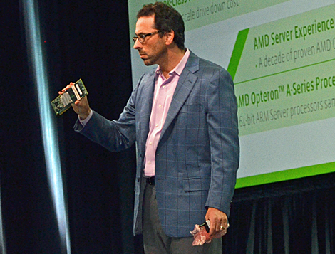 "Andrew Feldman, Corporate VP and GM, AMD, holds up an ARM server board during his talk on ""Disruptive Technologies in the Data Center."" (Photo by Colleen Miller.)"