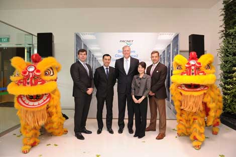 Pacnet SGCS2 opening ceremony included colorful festivities. Pictured from left: Jim Fagan, President for Managed Services at Pacnet; Marcus Cheng, CEO at Acclivis; Carl Grivner, CEO at Pacnet; Jacqueline Poh, Managing Director of Infocomm Development Authority of Singapore; Giles Proctor, Vice President for Data Center Construction and Operations at Pacnet.