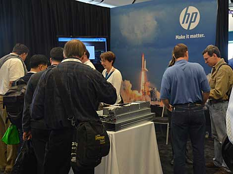 Attendees review gear at the HP booth at the fifth Open Compute Summit in San Jose, CA, last week. The event drew about 3,500 participants, who were eager to see what vendors have produced with OCP designs. (Photo by Colleen Miller.)