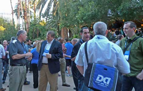 Networking by the pool was very popular. The reception was sponsored by WiredRE. (Photo by Colleen Miller.)