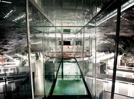 "The ""floating room"" at the Pionen underground data center, a glass-enclosed conference room raised above the data hall within the subterranean facility. (Photo: Bahnhof)"