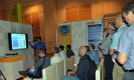 Several vendors conducted informational sessions and demonstrations in the exhibit hall. This presentation from Emerson Network Power drew a small crowd. (Photo by Colleen Miller.)
