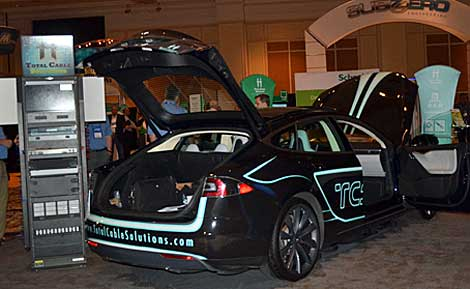 A cable solutions company drove this Tesla electric vehicle from Dayton, Ohio, to Las Vegas, Nev. to the show floor. (Photo by Colleen Miller.)