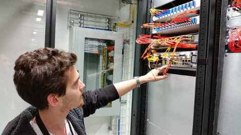 Yann Leger, vice president of cloud computing at Online.net Labs, pointing at a network switch powering the company's cloud.