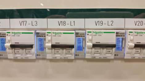 The data center's cooling capacity is adjusted automatically based on the amount of power consumed (power meters pictured)