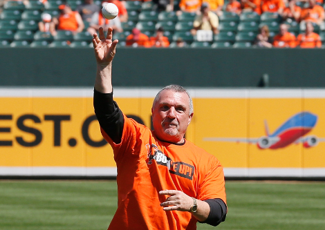 Rudy Ruettiger, the Notre Dame football player whose quest to make the team was turned into the poplular movie 'Rudy,' throws out the ceremonial first pitch before the start of the Baltimore Orioles and Tampa Bay Rays game at Oriole Park at Camden Yards on September 13, 2012 in Baltimore, Maryland. (Photo by Rob Carr/Getty Images)