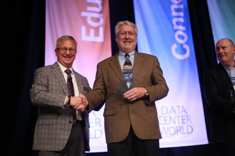 AFCOM President Tom Roberts presents the Data Center Manager of the Year award to this year's winner Michael Cunningham, of University of Texas at Austin.