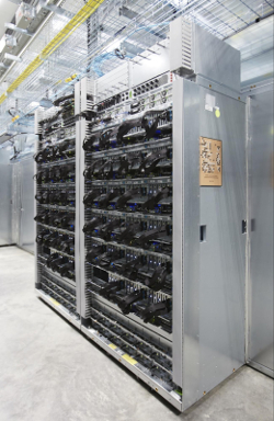 Google's Tensor Processing Unit boards fit into server hard drive slots in the company's data centers. TPU is a custom chip Google designed specifically for machine learning applications. (Photo: Google)