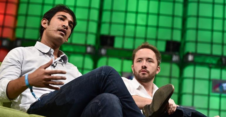 Dropbox CTO Aditya Agarwal, left, and Drew Houston, the company's founder and CEO, speaking at a conference in 2014.