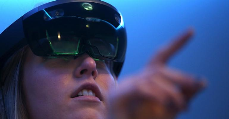 Microsoft employee demonstrates the Microsoft HoloLens augmented reality (AR) viewer in March 2016 in San Francisco