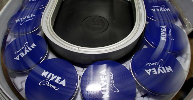 Nivea cream cans in a Beiersdorf factory in 2010 in Hamburg, Germany.