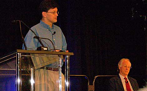 Chris Malone of Google speaks Tuesday at the Uptim Institute Symposium 2009 in New York, while Uptime founder Ken Brill listens.