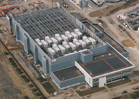 An aerial view of the Microsoft data center in Dublin showing the rooftop air handler units atop the first phased of the facility, as well as the vacant roof space available for additional air handlers as the remainder of the facility is built out.