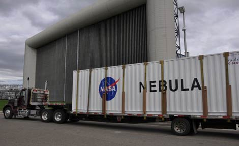 The Verari data center container housing the NASA Nebula cloud computing application arrives at Ames Research Center in Mountain View, Calif.