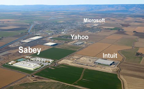 An aerial view of Quincy, Washington showing the cluster of major data centers, including a visualization of a planned site for Sabey Corp. and existing sites for Microsoft, Yahoo and Intuit.  A coalition of data center companies is seeking to reinstate tax breaks in Washington state that helped develop the Quincy cluster. (Image: Sabey Corp.).