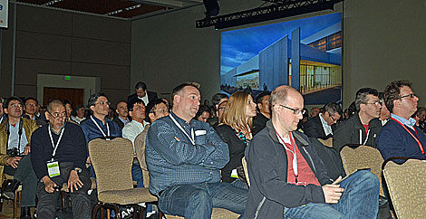 The audience in the ballroom at the fourth Open Compute Summit was listening to the presentation  from industry experts.