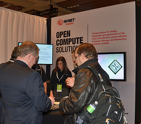 Attendees to the Open Compute Summit IV converse at the Avnet booth. (Photo by Colleen Miller.)