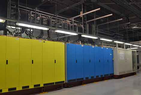 Inside the facility, the dual power systems are color coded with yellow and blue. (Photo by Colleen Miller.)