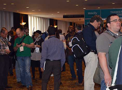 The event drew quite a crowd, who were checking their phones and catching up with colleagues. When the conference opened, co-chair Steve Souders of Google noted that start-up companies have formed just from the hallway and lunch table conversations that were initiated at Velocity. (Photo by Colleen Miller.)
