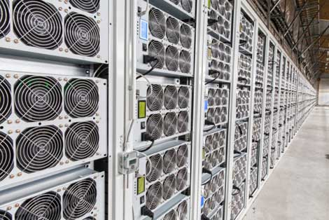 These racks of high-density Bitcoin mining rigs stretch the length of the building in the BitFury hashing center in  the Republic of Georgia. (Photo: BitFury)